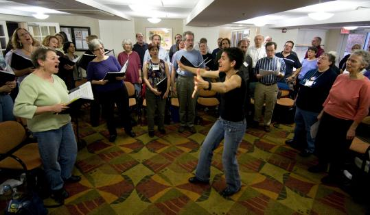 "Lisa Gallatin leads singers in ""Der Yid Der Shmid"" last month in Brookline. A Besere Velt is the largest Yiddish chorus in the world."
